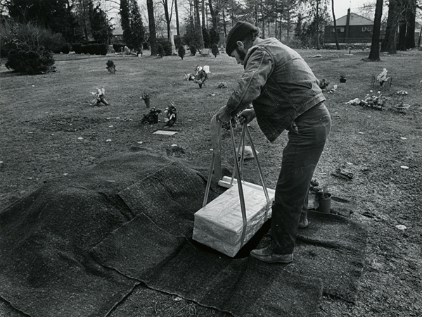 Grave digger James Thompson lowers a pet into a grave. February 1, 1972. Reprinted with permission of the DC Public Library, Star Collection © Washington Post