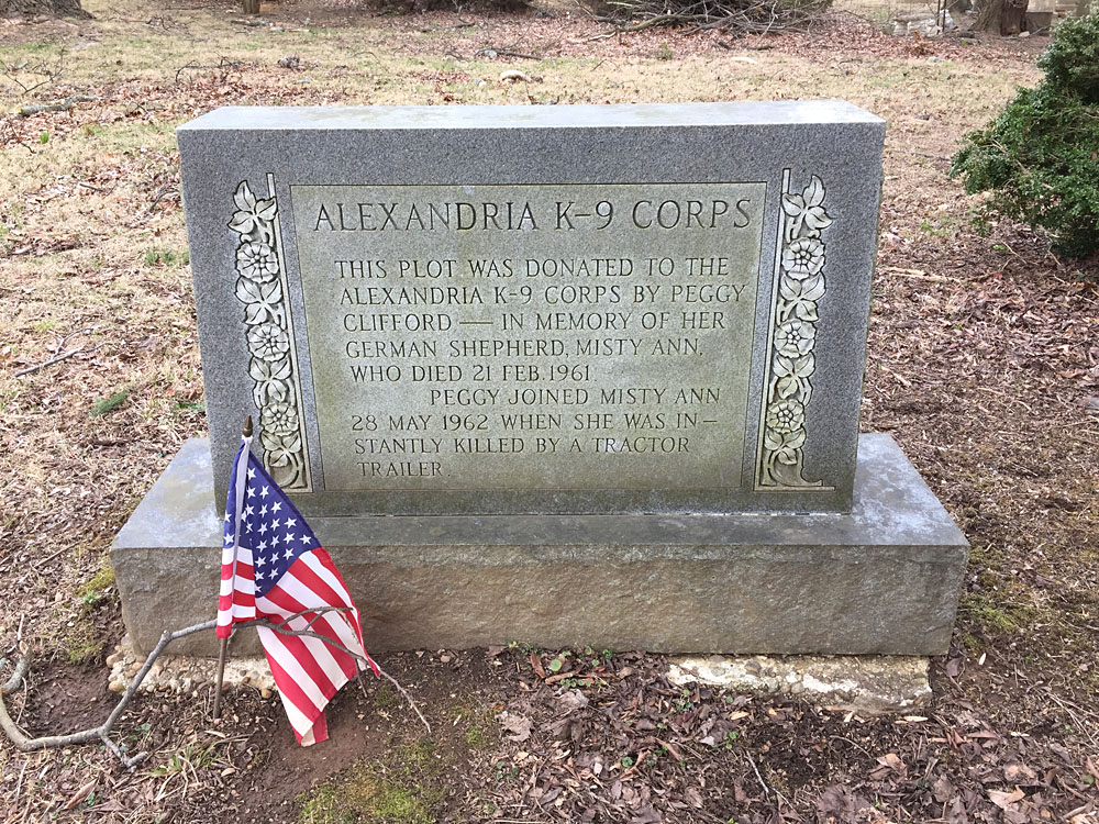 Alexandria K-9 Corps. This plot was donated to the Alexandria K-9 Corps by Peggy Clifford - in memory of her German Shepherd, Misty Ann, Who Died 21 Feb 1961. Peggy joined Misty Ann 28 May 1962 When she was instantly killed by a tractor trailer. (March 2018)