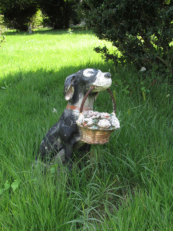 Dog statue with basket of flowers. (September 2014)