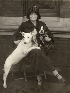 """Mrs. L. V. Carr with Billy Girl and Aspin Hill Flapper, two dogs that have attracted a considerable amount of attention."" Evening Star, January 26, 1924, pg. 16. National Photo Company Collection, Library of Congress. LOT 12296 (H) Volume 1, p. 11 (mislabeled ""Mrs. P. E. Smith, etc."")"